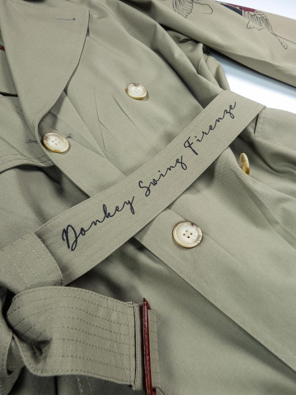 Grey-green trench coat with japanese tattoos