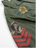 Olive green BDU shirt jacket with old school tattoos